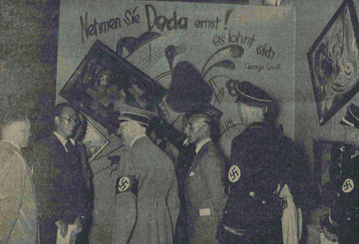 <p>Adolf Hitler and other Nazi officials at the Dada wall of the <em>Degenerate Art</em> exhibition, July 16, 1937.</p>