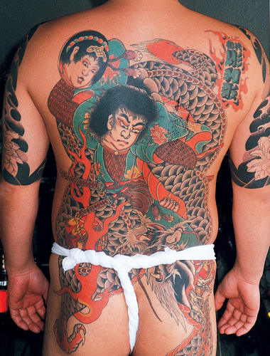 <p>Japanese gangsters, called Yakuzas, take off their kimonos to impress their opponent with their body tattoos during the notorious card game hanafuda, played in illegal gambling dens.</p>