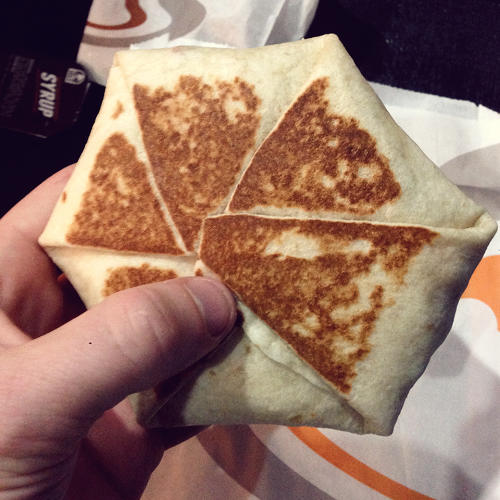 <p>The Breakfast Crunchwrap: Eggs, cheese, bacon, and hashbrowns stuffed into a toasted tortilla saucer.</p>
