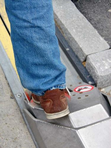 <p>While sitting in the saddle, you stick out a foot, resting it on a steel plate.</p>