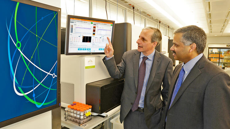 <p>Dr. Robert Darnell (left), CEO of the New York Genome Center, and Dr. Ajay Royyuru, Director of the IBM Computational Biology Center (right) discuss how IBM's Watson will be used to make sense of vast amounts of genetic sequencing data and medical information to identify personalized treatments for cancer patients, at an event at the New York Genome Center in New York City on March 19, 2014. IBM and NYGC will soon begin testing a Watson prototype designed specifically for genomic research to help oncologists deliver unique, customized cancer treatments according to an individual patient's DNA.</p>