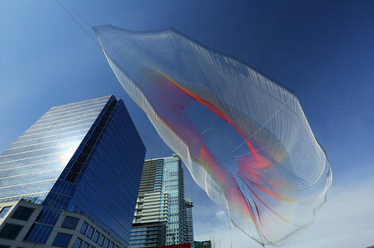 <p>To make the sculpture interactive, Koblin projected a huge Google Chrome browser window onto the sculpture (which is suspended from nearby buildings).</p>