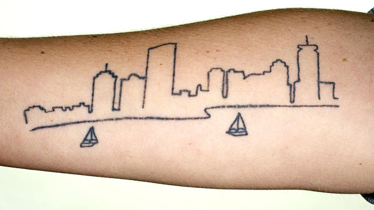 <p>The tattoo on Kate's arm is based on a photograph she took. She kayaks the Charles River and this is the view from the middle of the river.</p>
