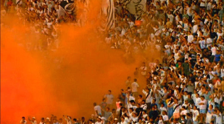 <p>This crowd scene, captured at a Brazilian stadium, is featured in a DVD video installation with audio and fabric enclosure.<br /> Stephen Dean</p>