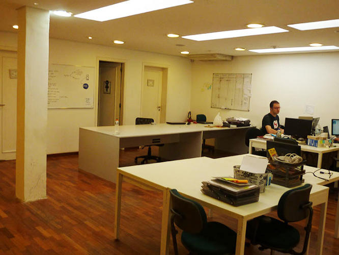 <p>The building is a combination of a co-working space and a hacker house, with beanbag chairs, a ping-pong table, and lots of coders and entrepreneurs working intently at their laptops.</p>