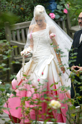 <p>Also on view is the pink-drenched Dior gown that Gwen Stefani wore in her wedding to Gavin Rossdale--two colorful designs that expressed the 21st-century woman's freedom of choice.</p>