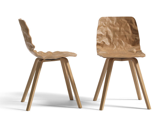 <p><a href=&quot;http://www.blastation.com/&quot; target=&quot;_blank&quot;>Bla Station</a>'s crumpled paper shell of a chair was created in an experiment to see if standard veneer could take on a 3-D form. It did, and now the Swedish design studio has released it as the Dent chair.</p>