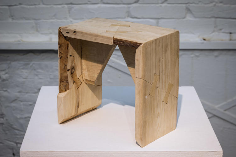 <p>So the artist instead took four pieces of scrap wood from the workshop and assembled them into a stool using nail-less carpentry--a method that's popular in rural China, but is in decline because of the rise of mass-produced items.</p>