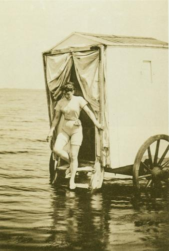 <p>The idea was that a woman would walk into such a booth, and begins changing. When she was done, a horse would be hitched to the machine, and drag her out to sea, where it would operate as a floating changing buoy.</p>