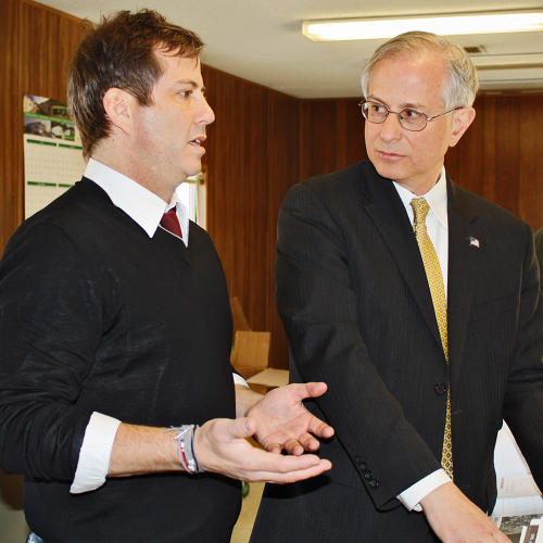 <p>Ironstate co-president <strong>David Barry</strong> looks over plans with Staten Island deputy borough president <strong>Edward Burke</strong></p>