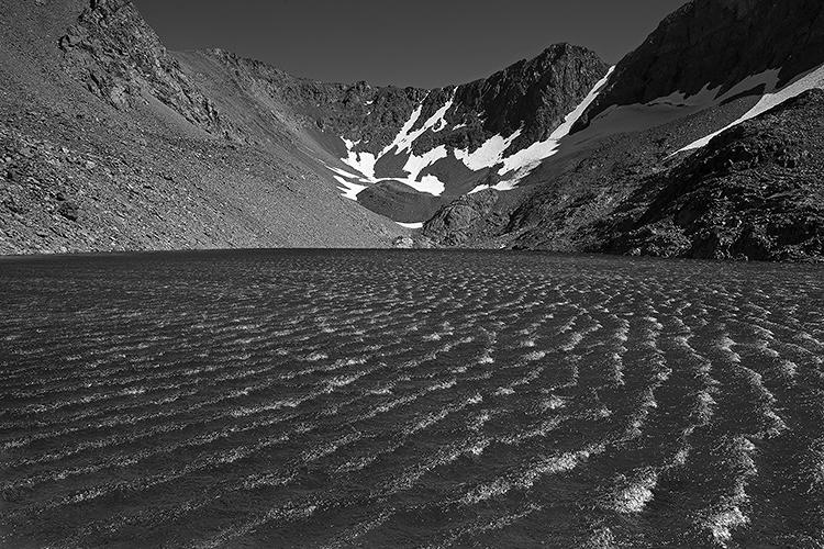 <p>In Ansel Adams Wilderness, a strong summer wind makes whitecaps on Dana Lake.</p>