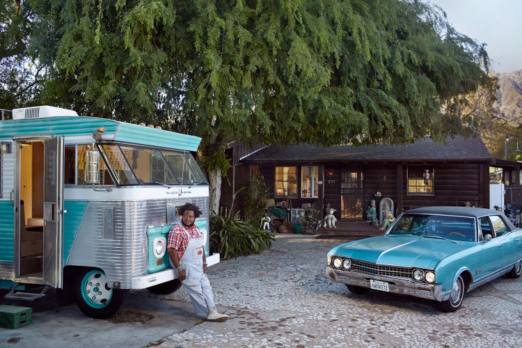 <p>John Agnew and his 1966 Oldsmobile 98 and his 1964 Ford Condor at home in Altadena, California.</p>