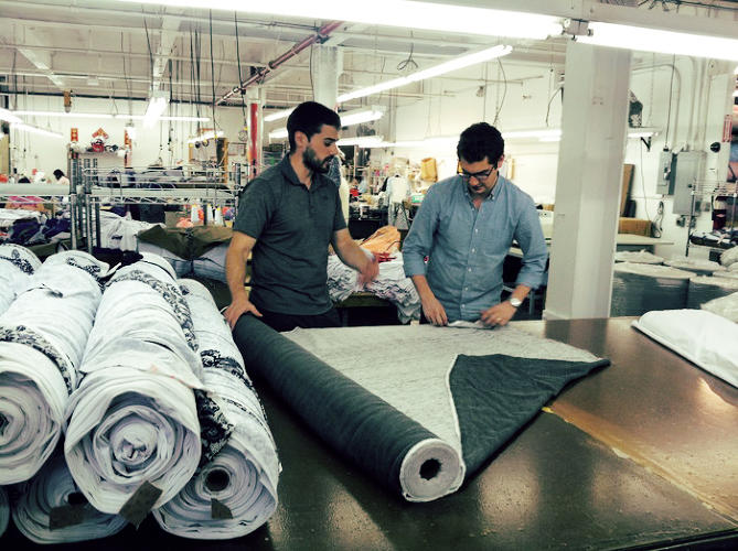 <p>Brooklinen cofounders Rich Fulop and Dave Fortune, pictured, slot their production runs into lulls at large factories to save money.</p>