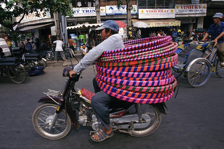 <p>In Saigon, locals have mastered the art of riding motorbikes to carry anything and everything.</p>