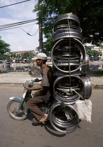 <p>Since he first started photographing the bikes about a decade ago, roads have widened, making it easier to drive, and more people have the disposable income to buy cars.</p>