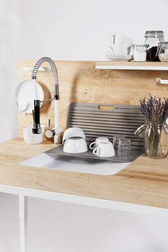 <p>A sloped sink lets you easily slide heavy pots onto the counter.</p>