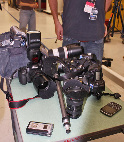 <p>Reporters set their equipment aside for a special cleaning prior to entering the clean room.</p>