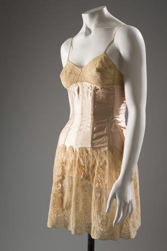 "<p>""Demure styles often gave way to designs as colorful and decorative as they were functional.""  An &quot;all-in-one&quot; Cadolle girdle of satin, lace, and elastic, circa 1930, France.</p>"