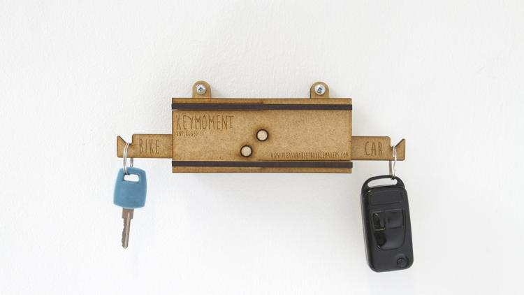 <p>The Keymoment is a key rack that holds your bike key and car key at opposite ends. If you choose the car key, the bike key will automatically drop to the ground, forcing you to pick it up and hold both keys in your hands. Suddenly you're considering the bike ride one more time.</p>