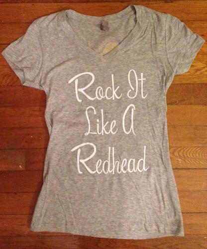 "<p>The shirt that signals a movement. Oh, and that boy Adrienne used to know, who once told her to dye her hair black? ""Last time I checked, he's dating a redhead.""</p>"