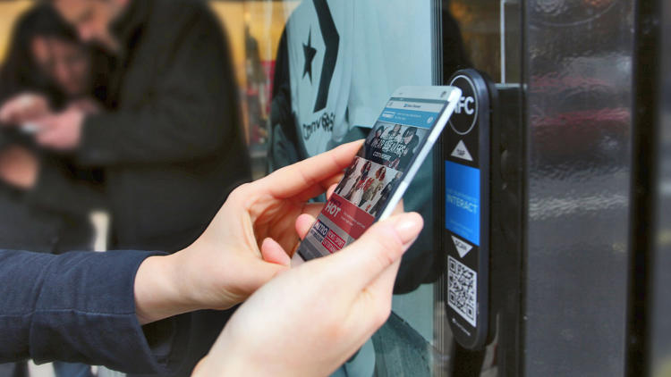 <p>Clear Channel's new billboards use NFC and other technologies to beam content to smartphones.</p>
