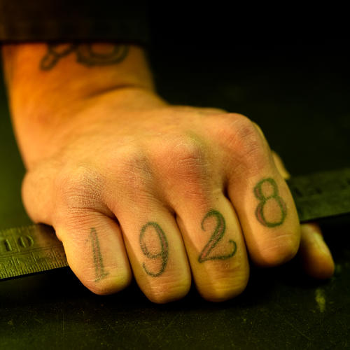 <p>AO Johnson and Sons Hardware. Employee Brady tattooed the company's founding year on his knuckles.</p>