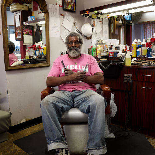 <p>Satin Wave Beauty and Barber Shop, Milwaukee, established circa 1955 by James &quot;Flip&quot; Flipping. Ronnie Sherrill, pictured here, is Flip's nephew.</p>