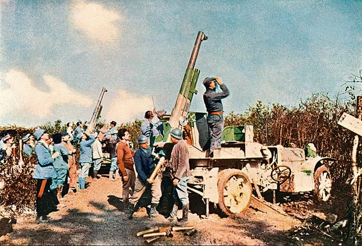 <p>Many don't know that World War I was the first major conflict to be documented in the then-new medium of color photography. Here, a motorized gun carriage with an antiaircraft gun, Verdun, 1916.</p>