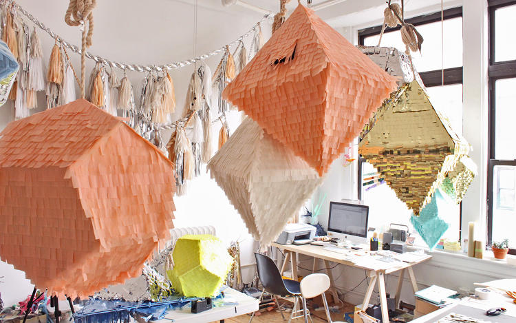 "<p>View of CONFETTISYSTEM New York Studio, 2012</p>  <p>Brooklyn-based design duo Nicholas Andersen and Julie Ho, whose piñatas are shown here, created lobby décor for the exhibition. ""They hand-make objects or hangings for environments out of simple, easily accessible materials like paper or Mylar,"" says Yuzna. ""They're one of many practitioners today who exist between different sectors of culture: fine art for MOMA P.S. 1, décor for stores, objects for their friends' living rooms. You can call them craftsman, designer, artist; it doesn't matter to them.""</p>"