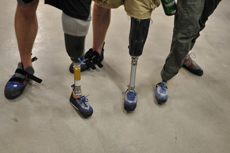<p>Amputee members of LIM359 in Denver show off their footwear.</p>