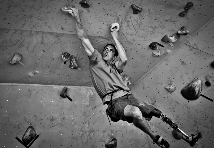<p>Ronnie Dickson competes in a bouldering event at the GoPro Mountain Games in Vail Colorado</p>