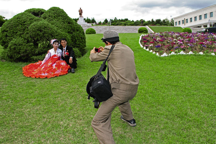 <p>She spent a week traveling the entire country, documenting celebrations for the 100th birthday of Kim Il Sung, giant synchronized dances, nearly empty streets, and oddities like a children's museum featuring a nuclear missile.</p>