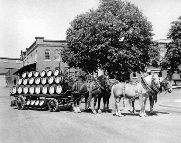 "<p>This image (from a circa 1970 beer festival) re-creates the type of wagon the company used in the 1890s to distribute Narragansett beer. ""There were thousands of breweries across America"" in that day, says Hellendrung, each serving its own city or even neighborhood. The wooden barrels of the era are twice the size of the average keg today.</p>"