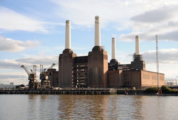 <p>The decommissioned Battersea Power Station, South West London, UK, constructed between 1929 and 1935, designed by a team of engineers headed by Leonard Pearce and the architect Theo J. Halliday, but Sir Giles Gilbert Scott also worked on the project.</p>
