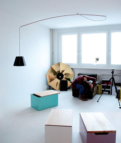 <p>The Mokka Light, by 45 Kilo, uses a classical geometric lampshade made from passe-partout (framing board), standard copper piping, and some electrical wire. The lamp seems to float in the room.</p>