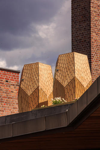 <p>Building beautiful beehives probably won't solve the problem, but they do provide a visible symbol for the city's desire to cultivate bee habitats.</p>