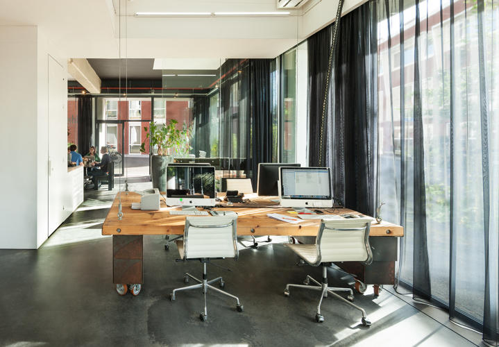<p>During work hours, the desks balance on rolling cabinets to keep them at the correct height and steady.</p>