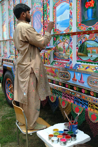 <p>Haider Ali paints a truck at the National Mall in Washington D.C. in 2002.</p>