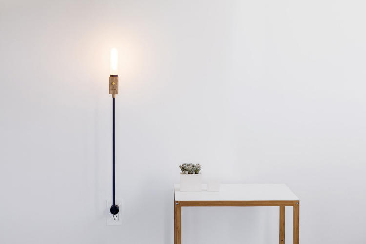 This Clever Lamp Grows Out Of Your Wall
