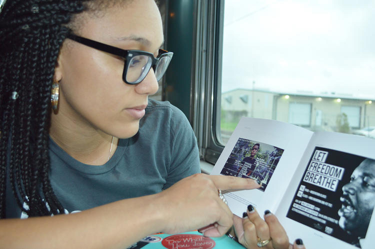 <p>Randi Gloss, who owns the t-shirt company Glossrags, rode the Millennial Train Project this past week. In each city the train pulled into, Gloss set up temporary shop, selling t-shirts and recording stories about police brutality.</p>