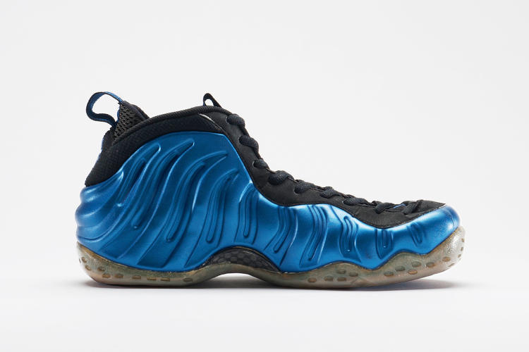 <p>Eric Avar designed Nike's Foamposite by formed the entire upper from a single piece of synthetic material. Basketball point guard Penny Hardaway wore the shoes, which only came in Dark Neon Royal Blue.</p>  <p>Nike Archives</p>