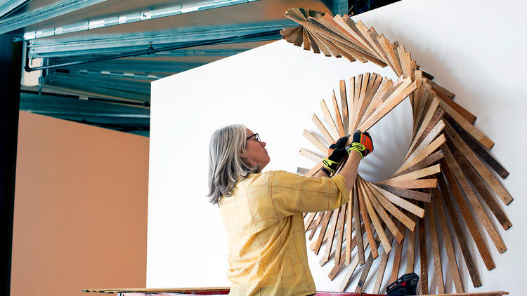 <p>Artist Barbara Holmes working on a public art installation at Facebook headquarters.</p>