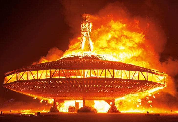 <p>Artists: The Man: Larry Harvey, Jerry James, Dan Miller, and the ManKrew. <br /> Man base: Lewis Zaumeyer and Andrew Johnstone.<br /> The Burning Man figure, atop his massive flying saucer base, burns dramatically at the festival's end.</p>