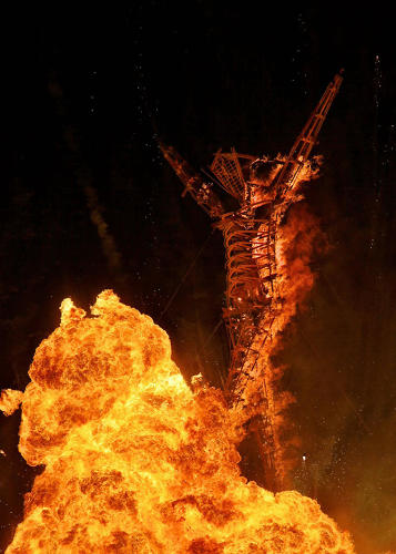 <p>Artists: Larry Harvey, Jerry James, Dan Miller, and the ManKrew<br /> The Burning Man effigy appears to walk into an enormous acetylene fireball.</p>