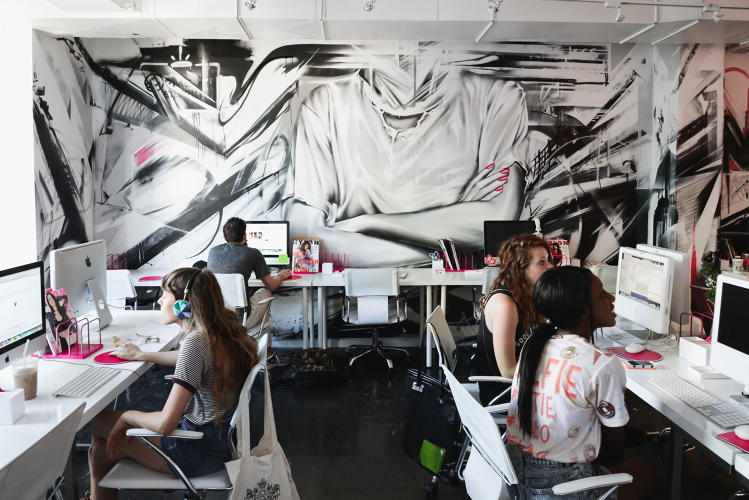 <p>The graffiti was done by artists Angelina Christina, Easeone, and Sek. It perfectly matches the brand's &quot;tough with a bit of pink&quot; attitude.</p>