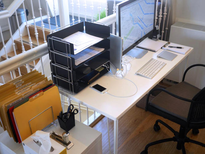 "<p>The in-basket is one of the most important tools on Allen's desk, and it keeps his workspace clean. ""It's the funnel for miscellaneous things you haven't decided about yet, such as mail or meeting notes,"" he says. ""Throw them in there. It's the one place that gives you freedom and discipline to capture unprocessed stuff so it's not thrown all over the desk.""</p>"