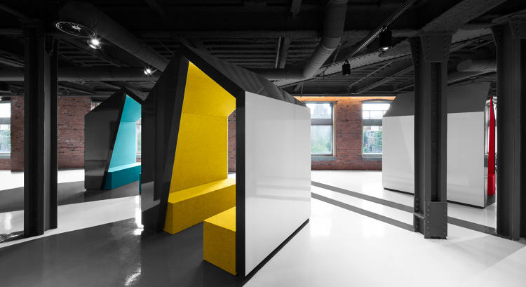 <p>Cabanas modeled off of traditional Canadian fishing huts offer semi-private space for meetings.</p>