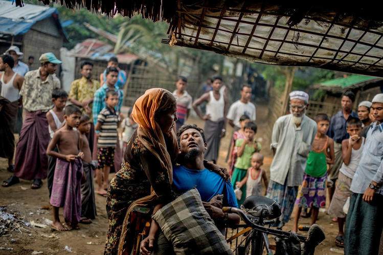 <p>&quot;Muzammil, 37, is comforted from his pains by his stepmother while waiting outside a pharmacy for the pharmacist to arrive. Incredibly poor sanitation in the area make deaths from diarrhea and stomach infections all too common. &quot;</p>