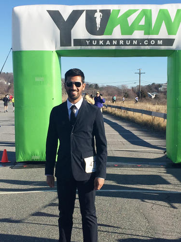 <p><strong>Amarasiriwardena</strong> at the finish line of the Half MerryThon in Gloucester, Massachusetts, on December 6, 2015, wearing a suit of his own creation: the Aviator 2.</p>