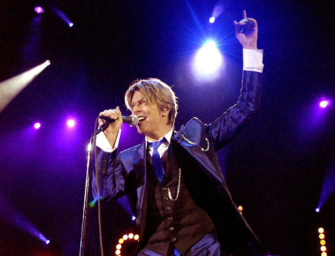 <p>Even in 2002, performing at the Hammersmith Apollo in London, David Bowie was making a sharp fashion statement with this Prince-like purple tux.</p>